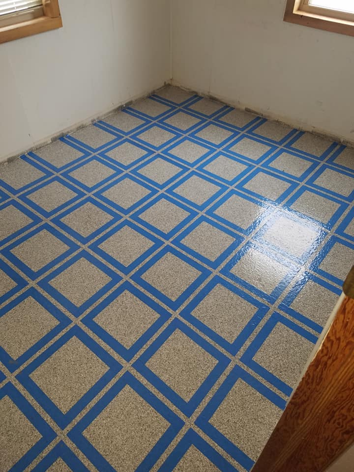 blue grid pattern on floor coating