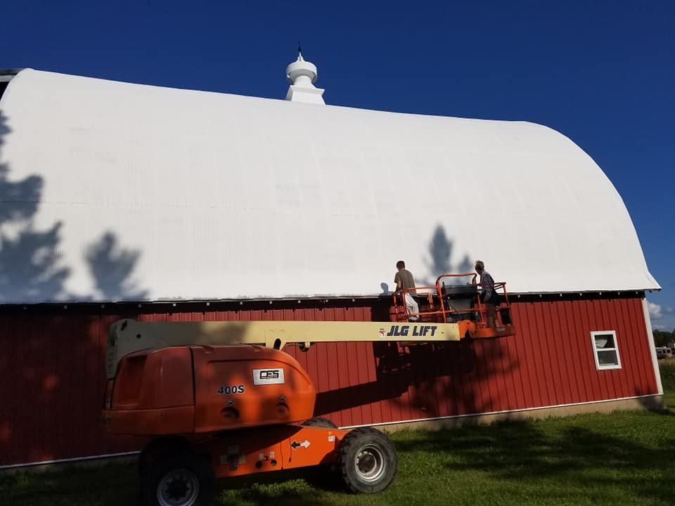 Roof coating on classic red barn